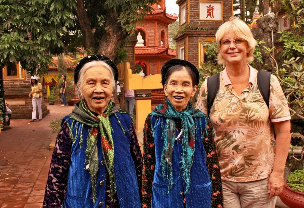 Barbara meets two women in Hanoi, Vietnam, who chew Betel nut to make their teeth black. This is considered a sign of beauty in their tribe.